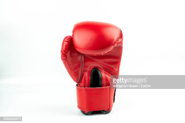 close-up of boxing glove over white background - boxing gloves stock photos and pictures