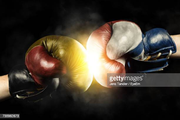 Close-Up Of Boxing Gloves Against Black Background