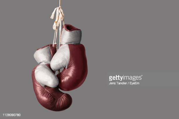 close-up of boxing gloves against gray background - boxing gloves stock pictures, royalty-free photos & images