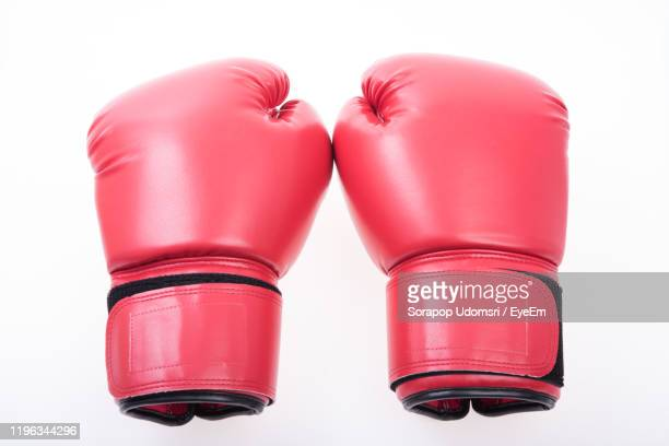close-up of boxing gloves over white background - boxing glove stock pictures, royalty-free photos & images