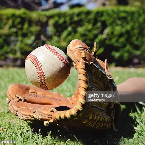 close-up of boy catching a baseball in baseball glove - baseball glove stock pictures, royalty-free photos & images