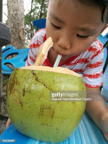 Close-Up Of Boy Drinking Coconut Water