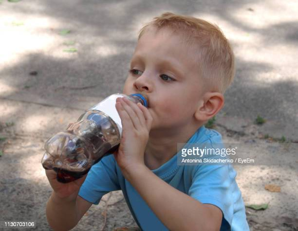 Close-Up Of Boy Drinking Cola