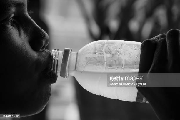 Close-Up Of Boy Drinking Water