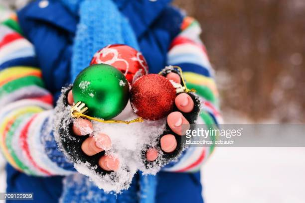 Close-up of Boy holding Christmas decorations