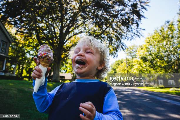close-up of boy holding ice cream - ice cream stock pictures, royalty-free photos & images