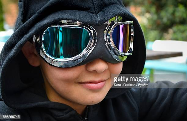 Close-Up Of Boy In Hooded Shirt Wearing Motorcycle Goggles