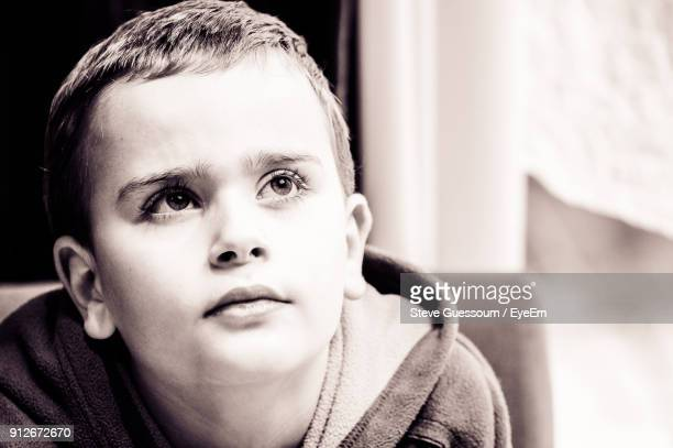 Close-Up Of Boy Looking Away At Home