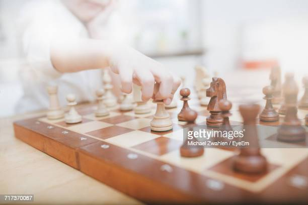 Close-Up Of Boy Playing Chess