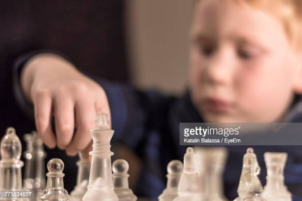 close-up of boy playing chess - reality kings stock pictures, royalty-free photos & images