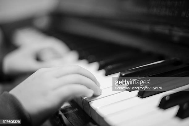 Close-Up Of Boy Playing Piano