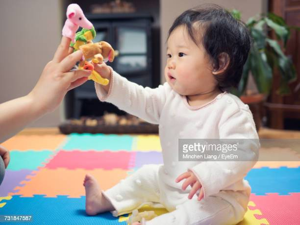 close-up of boy playing with finger puppets - puppet stock photos and pictures