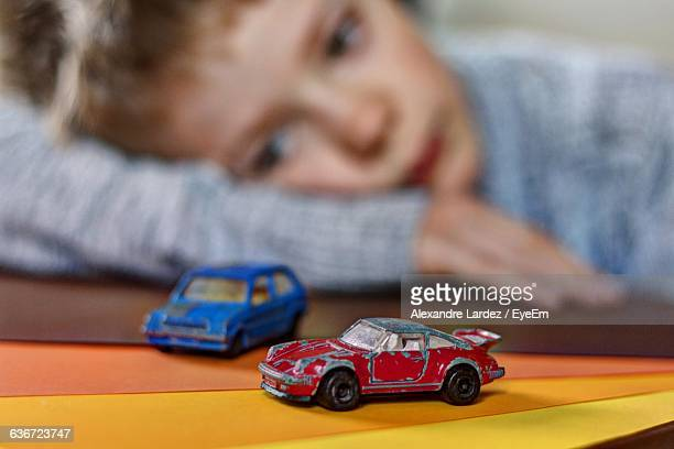 Close-Up Of Boy Playing With Toy Car At Home