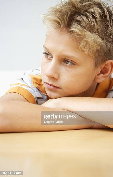 close-up of boy resting on a table - only boys stock pictures, royalty-free photos & images