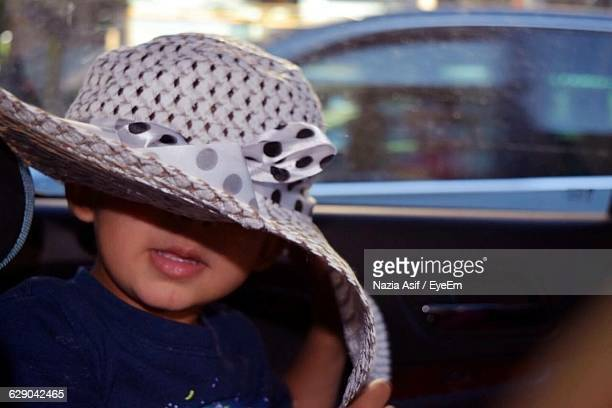 Close-Up Of Boy Wearing Hat In Car