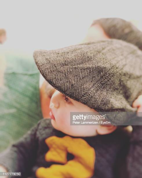 close-up of boy wearing hat - flat cap stock pictures, royalty-free photos & images
