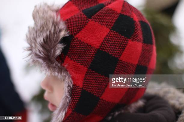 close-up of boy wearing knit hat - brianne stock pictures, royalty-free photos & images