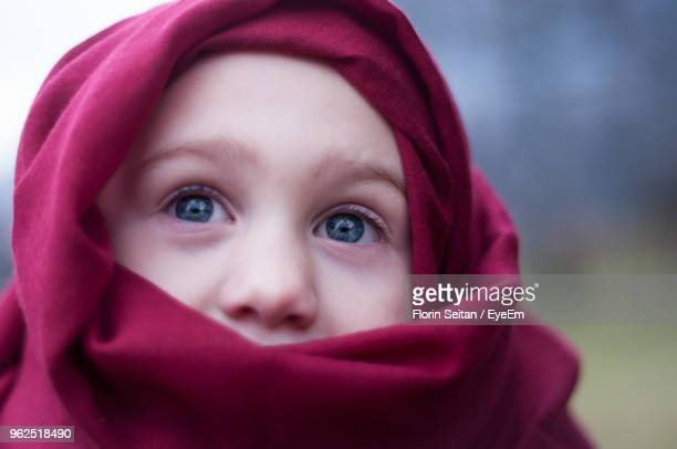 close-up of boy wearing red scarf while looking away - florin seitan stock pictures, royalty-free photos & images