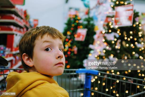 Close-Up Of Boy With Christmas Tree