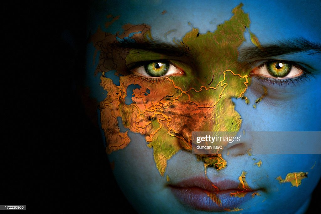 Close-up of boy with Earth map, Asia focus on face : Stock Photo