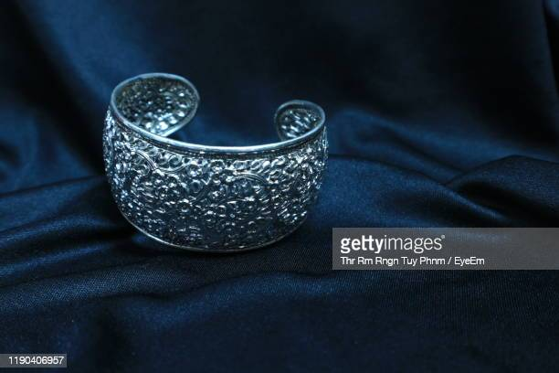 close-up of bracelet on fabric - jewellery stock pictures, royalty-free photos & images