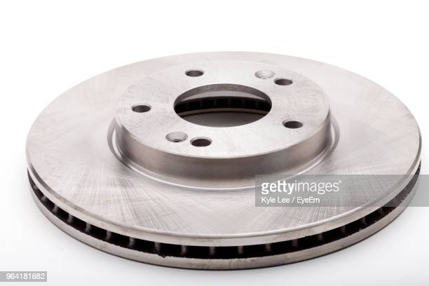Close-Up Of Brake Disc Over White Background