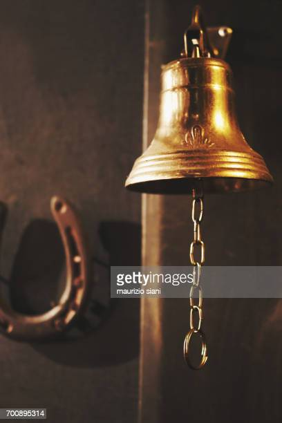 close-up of brass handbells on wall - bell stock pictures, royalty-free photos & images
