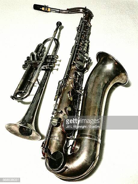 Close-Up Of Brass Instruments Against White Background