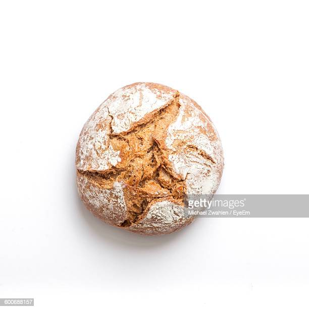 close-up of bread against white background - loaf of bread stock pictures, royalty-free photos & images