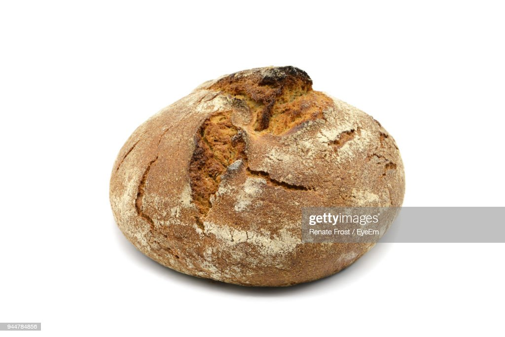 Close-Up Of Bread Against White Background : Stock Photo