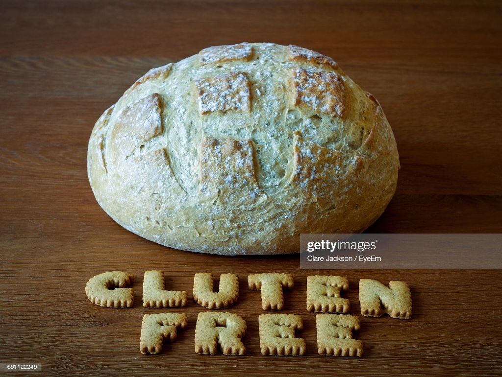 Close-Up Of Bread And Cookies In Text On Table : Stock Photo