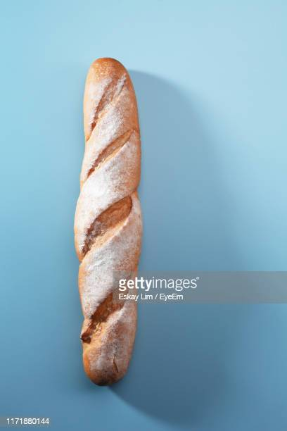 close-up of bread on blue background - baguette stock pictures, royalty-free photos & images