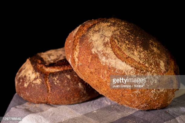 close-up of bread on table against black background,spain - brown stock pictures, royalty-free photos & images