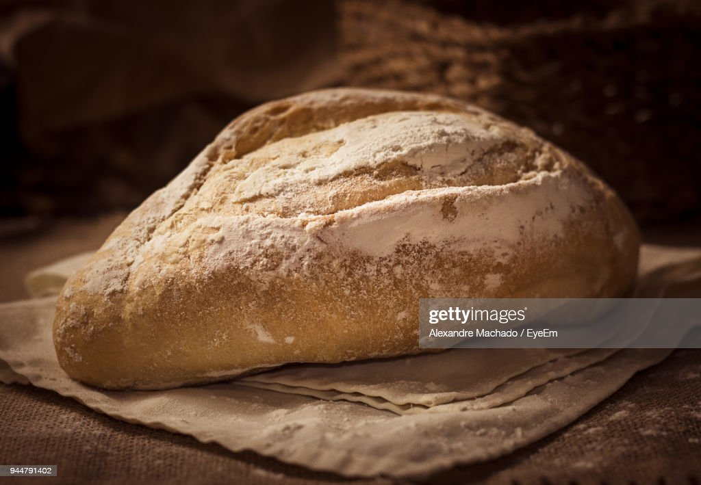 Close-Up Of Bread On Table : Stock Photo