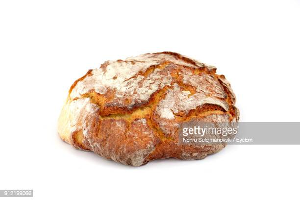close-up of bread over white background - loaf of bread stock pictures, royalty-free photos & images