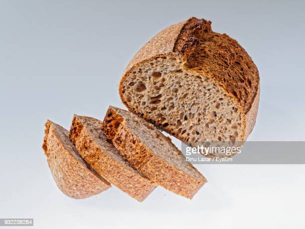 Close-Up Of Bread Slices On White Background