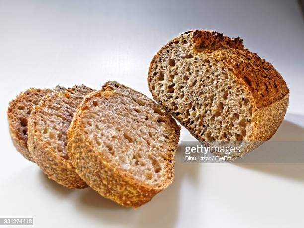 Close-Up Of Bread Slices On White Table