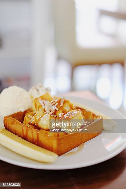 Close-Up Of Bread With Honey In Plate