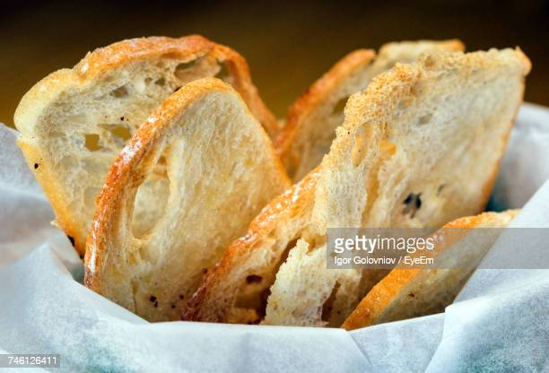 close-up of breads with fabric in container - igor golovniov stock pictures, royalty-free photos & images