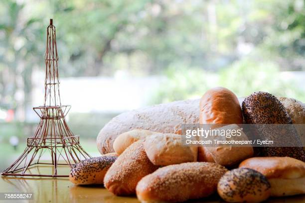Close-Up Of Breads With Replica Eiffel Tower On Table