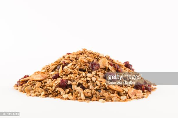 close-up of breakfast cereal over white background - granola stock pictures, royalty-free photos & images