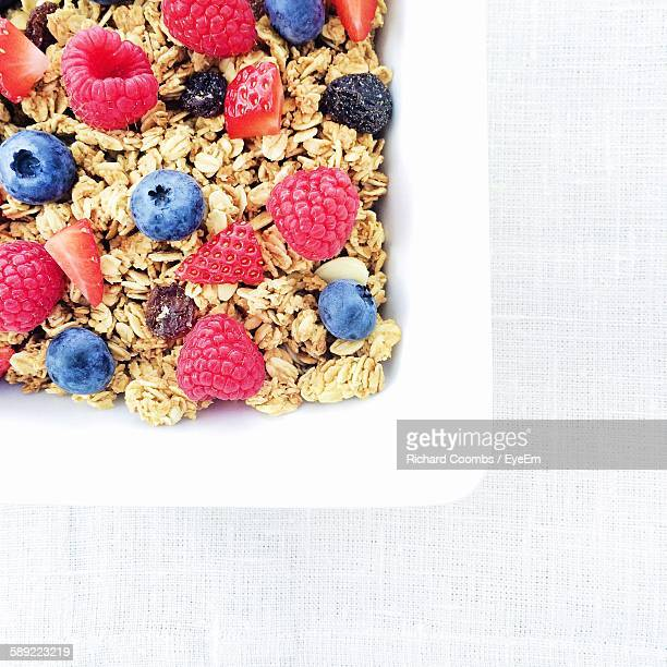 Close-Up Of Breakfast Cereal With Berries In Plate