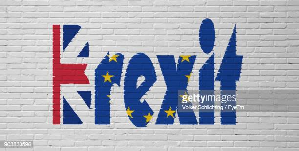 close-up of brexit text on white brick wall - brexit stock pictures, royalty-free photos & images