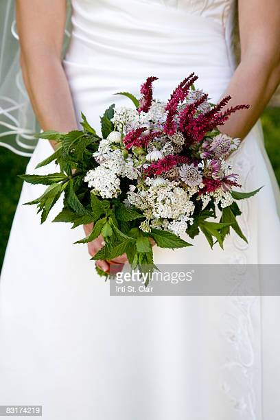 Close-up of bridal bouquet in bride's hands