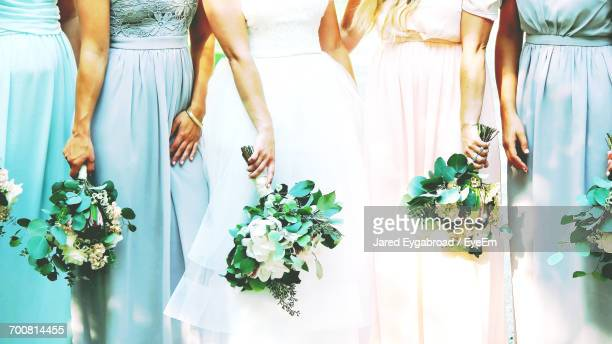 close-up of bride and bridesmaids - bridesmaid stock pictures, royalty-free photos & images