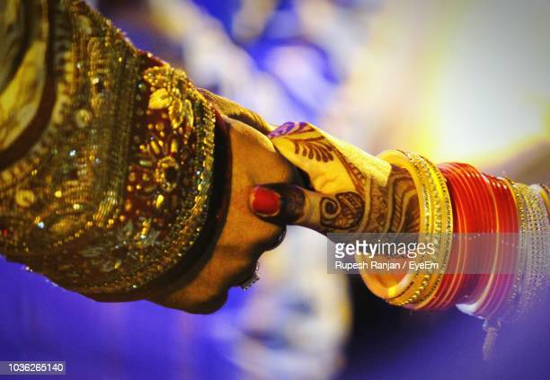 close-up of bride and groom holding hands - bangle stock pictures, royalty-free photos & images