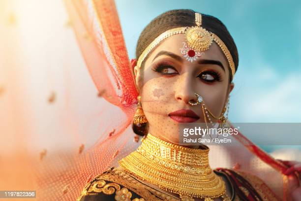 close-up of bride looking away against sky - necklace stock pictures, royalty-free photos & images
