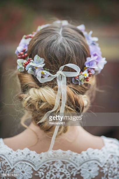 Close-up of bride wearing floral hair wreath