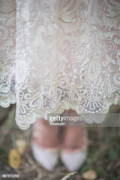 Close-up of bride wearing lace dress