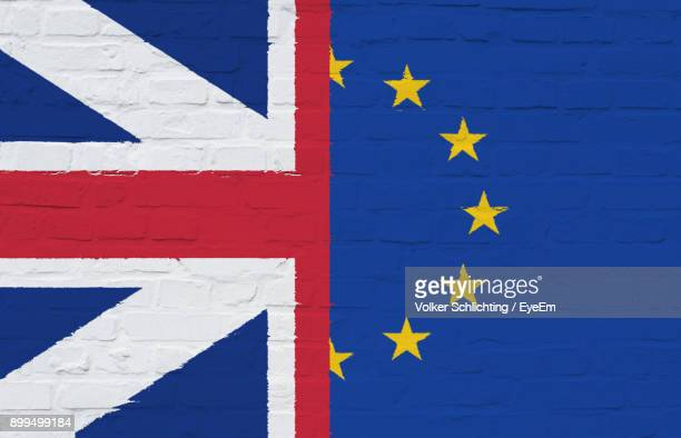 close-up of british and european union flag on brick wall - union jack stock photos and pictures